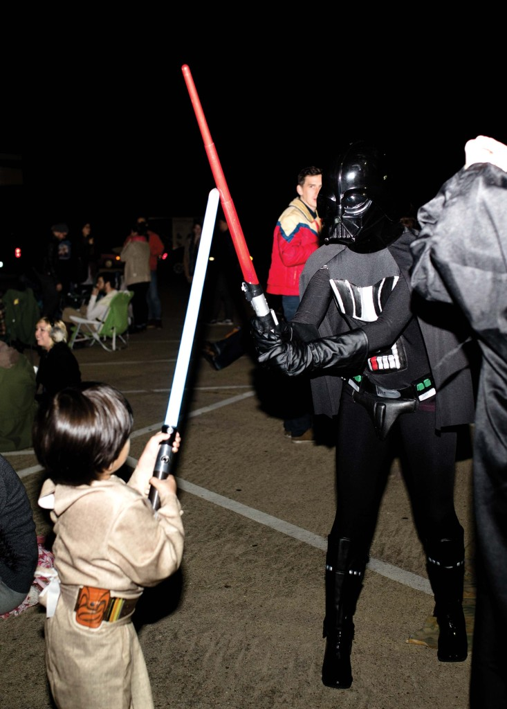 Kristen Cogswell, right, battles Mawlins' son as Darth Vader at the Star Wars movie night at Cross Timbers Church. Meagan Sullivan   Associate Visuals Editor