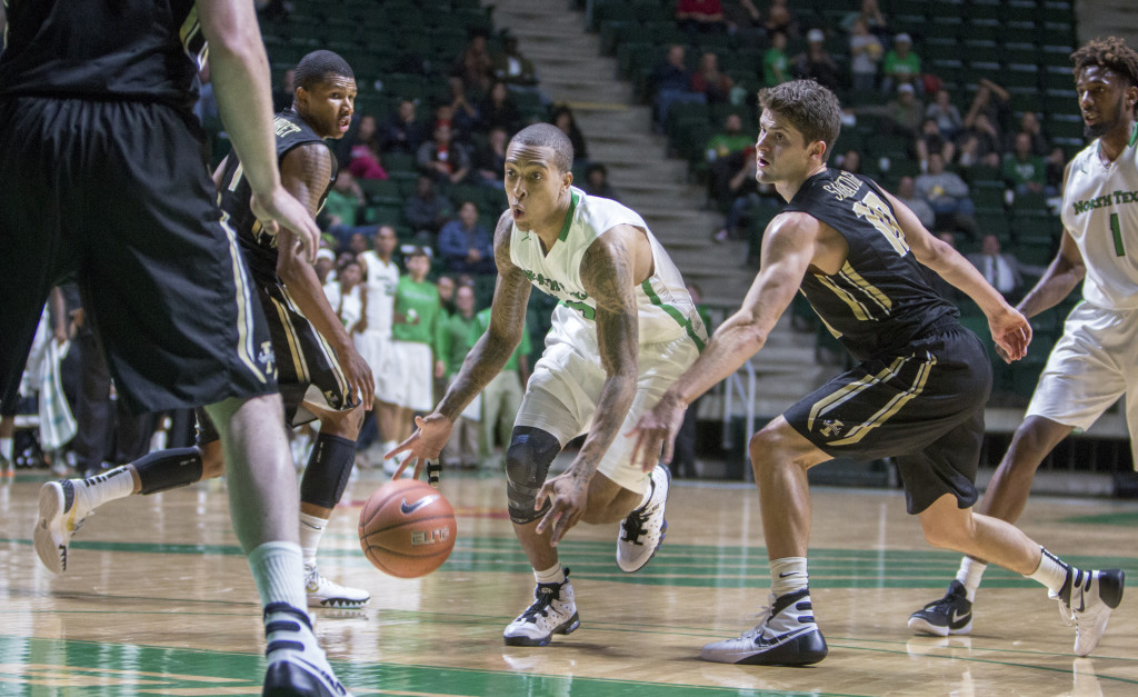 North Texas junior point guard J-Mychal Reese (52) drives toward the basket to put up a two point floater against Idaho. Colin Mitchell | Intern Photographer