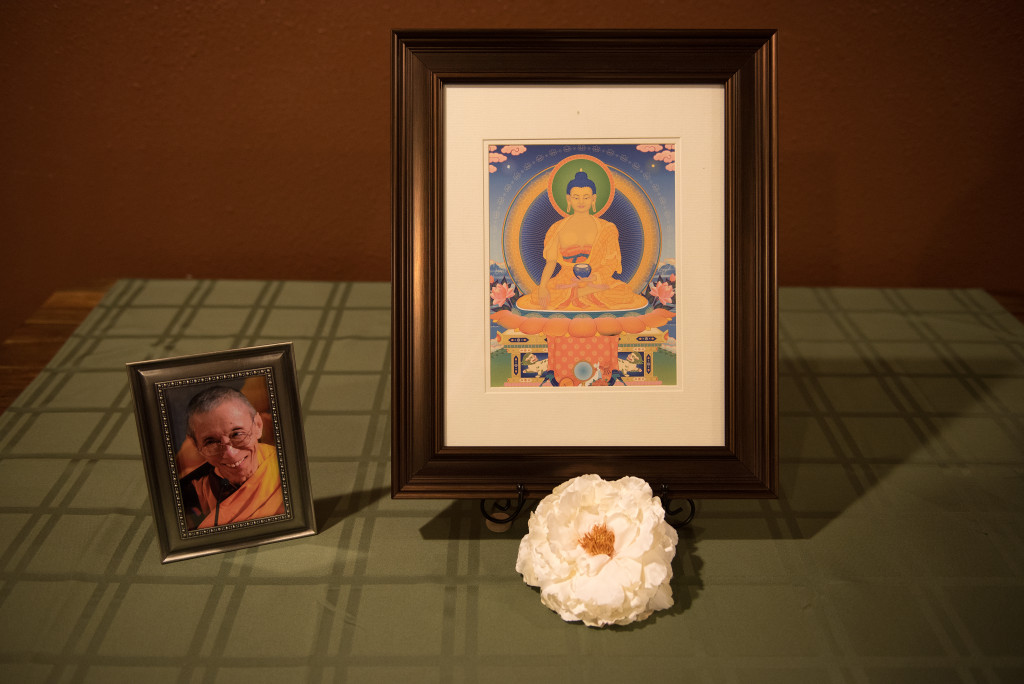 A portrait of Geshe Kelsang Gyatso, Modern Kadampa Buddhism teacher, is placed on the table whenever Jenny Streit-Horn teaches classes. Ranjani Groth | Staff Photographer
