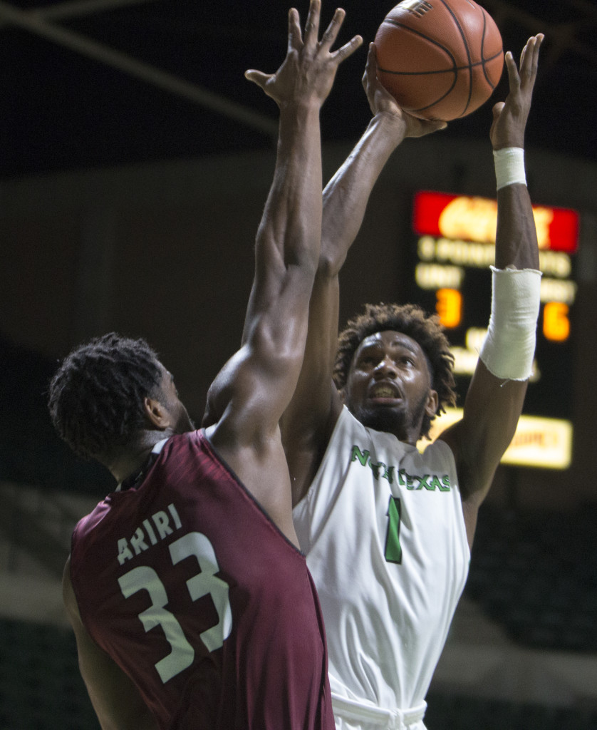 North Texas sophomore forward Jeremy Combs (1) drives the lane for a layup against Troy. Colin Mitchell | Intern Photographer