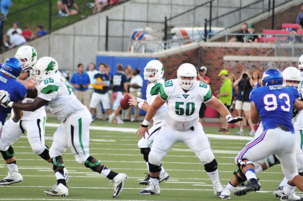 North Texas junior offensive lineman Kaydon Kirby (50) protects senior quarterback Andrew McNulty (5) against the Portland State defense. Ryan Vance | Senior Staff Photographer