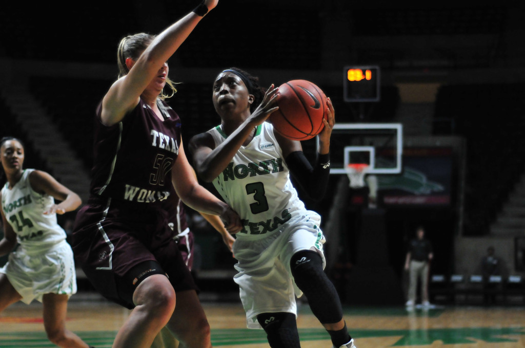 North Texas junior guard Kelsey Criner (3) dribbles down the court during an exhibition against Texas Woman's University. Ryan Vance | Senior Staff Photographer
