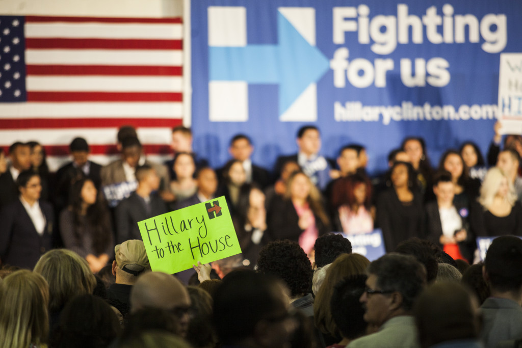 """A member of the crowd holds up a """"Hillary to the House"""" sign as they wait for Hillary to take the stage at Mountain View College in Dallas on Tuesday, November 17, 2015. Community members were forced to wait for a long period of time due to Clinton arriving late."""