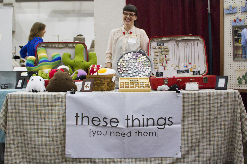 These Things owner Amy Nalley poses with her booth at the Dime Store's Handmade Harvest event on Nov. 6, 2015. Paulina De Alva | Staff Photographer