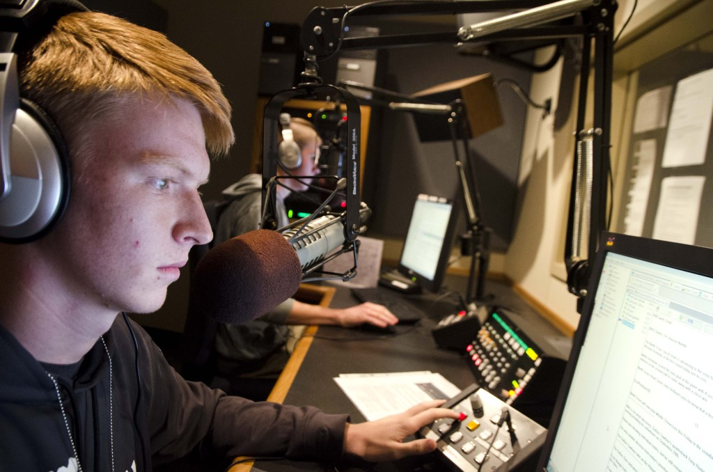 Grayson Nolette, left,  a freshman CBCM major and Ryan Roiz, right, a RTVF junior give the latest in sports and news at 4 o'clock. Hannah Ridings | Senior Staff Photographer