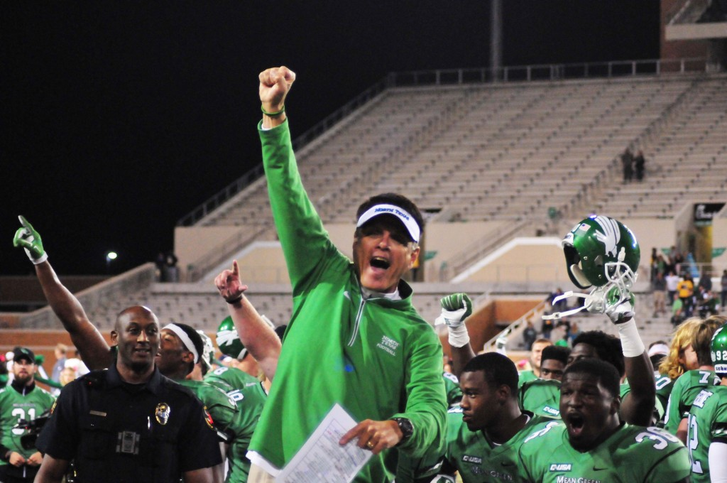 Interim head coach Mike Canales celebrates the first Mean Green win of the season. Ryan Vance | Senior Staff Photographer