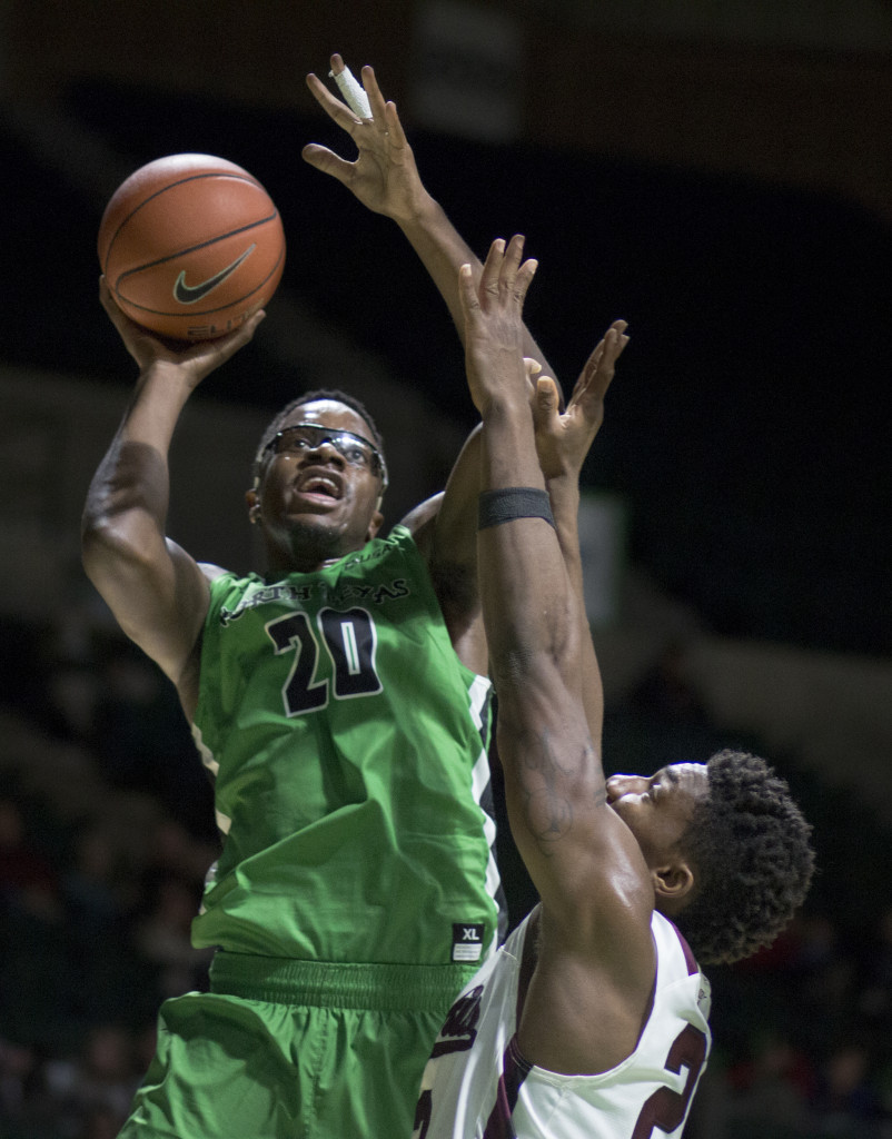 North Texas senior forward Eric Katenda (20) goes up for a baseline jumper against Southern Illinois. Colin Mitchell | Intern Photographer