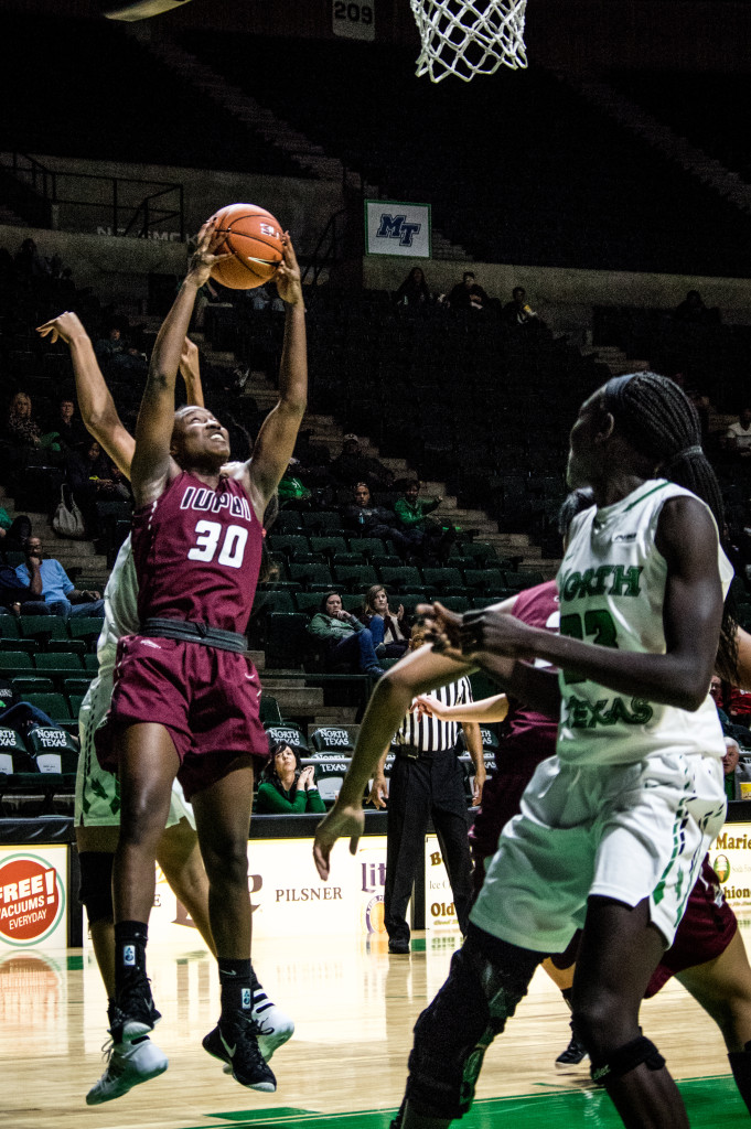 Jaguars' forward Akilah Sims(#30) scored 20 points but it wasn't enough to stop North Texas from making a comeback in the second half of Saturday's game. Matthew Brown | Senior Staff Photographer