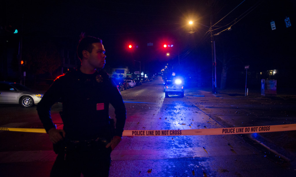 Police block off the road outside of the UCentre apartment complex on Fry St. Saturday night after a UNT police officer shot and killed a suspect. Hannah Ridings/North Texas Daily