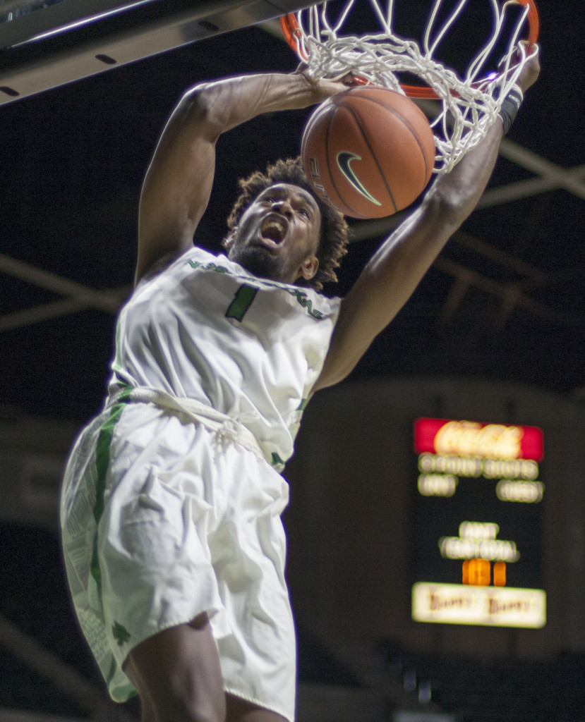 North Texas sophomore forward Jeremy Combs (1) throws down a dunk off of a break away against WKU. Nathan Roberts | Contributing Photographer
