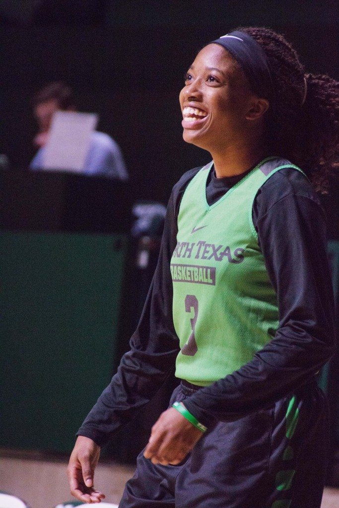 Junior guard Kelsey Criner laughs after shooting a basket in practice. Dylan Nadwodny | Staff Photographer