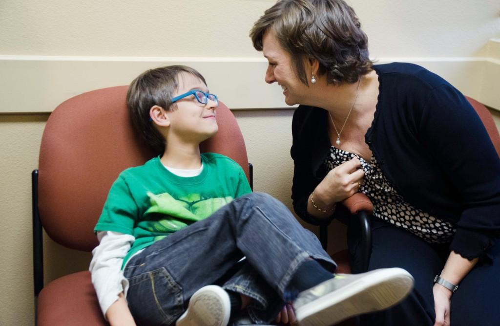 Dax and his mother Lisa Thakker smile at each other after receiving the good news that his eardrum looks great after looking at the x­ray results. Hannah Ridings | Senior Staff Photographer