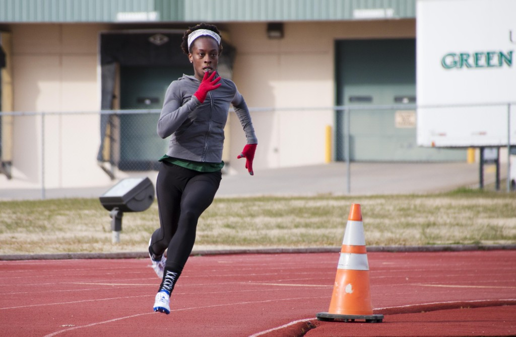 Sprinter and graduate student Nadiyah El-Amin rounds a corner duirng a practice. Dylan Nadwodny | Staff Photographer