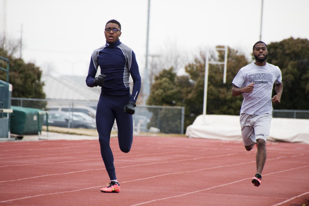 Business sophomore TeVaun Scallion (left) and kinesiology senior Caleb Pryor (right) work on sprints during practice. Dylan Nadwodny | Staff Photographer