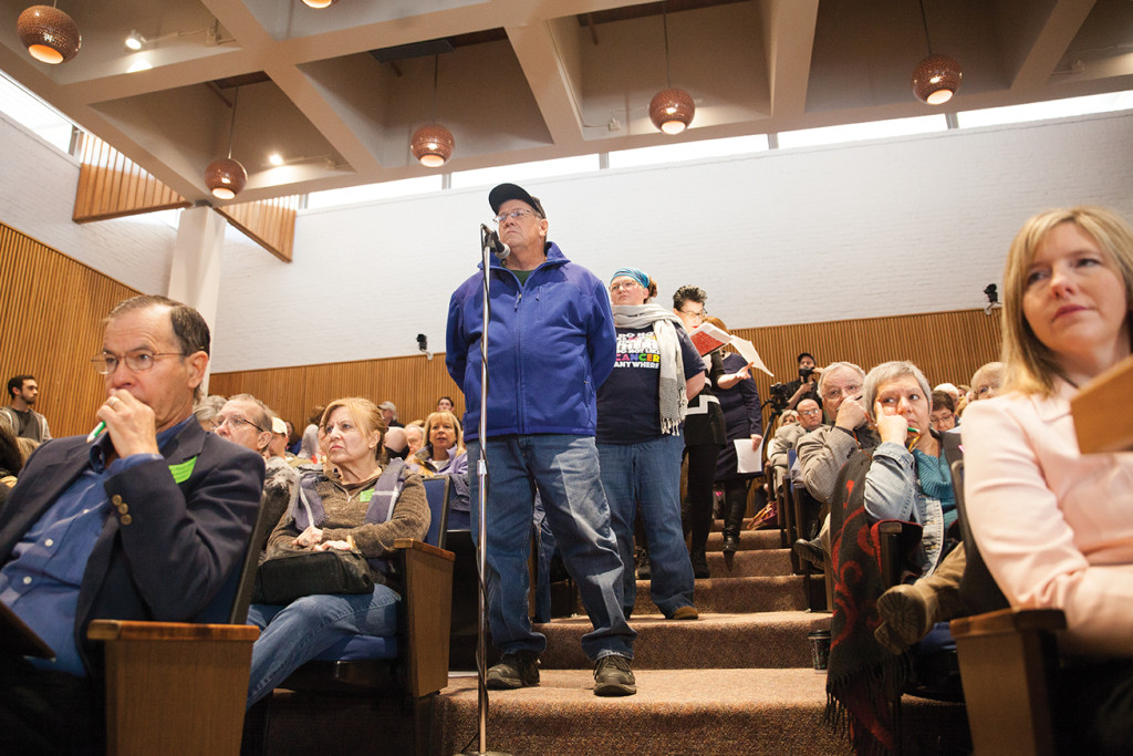 Citizens line up by a microphone to voice concerns and ask questions about the new Renewable Energy Plan during a Q&A with experts and employees from the city. Kristen Watson | Visuals Editor