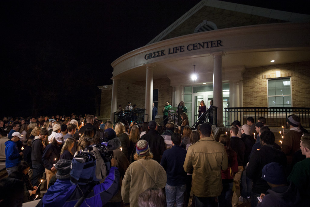 Several hundred people stand in front of UNT's Greek Life Center for a candlelight vigil held by Zeta Tau Alpha in memory of Sara Mutschlechner in front of UNT's Greek Life Center on Saturday, January 2, 2016. Kristen Watson | DRC