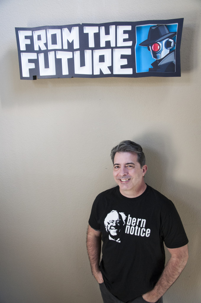 Founder and CEO of From The Future Mike Christain stands under his business sign. Sarah Bradbury | Staff Photographer