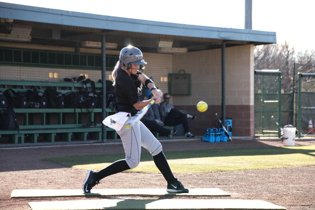 Junior infielder Kelli Schkade swings for the ball during practice. Dylan Nadwodny | Staff Photographer