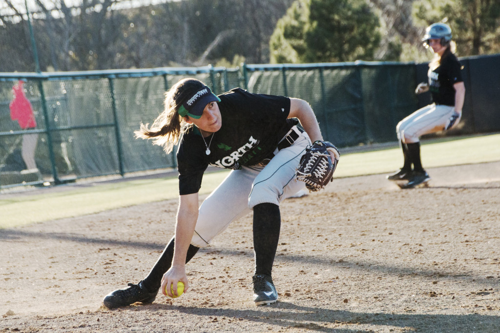 Senior utility player Karly Williams fields the ball near home plate during practice. Dylan Nadwodny | Staff Photographer