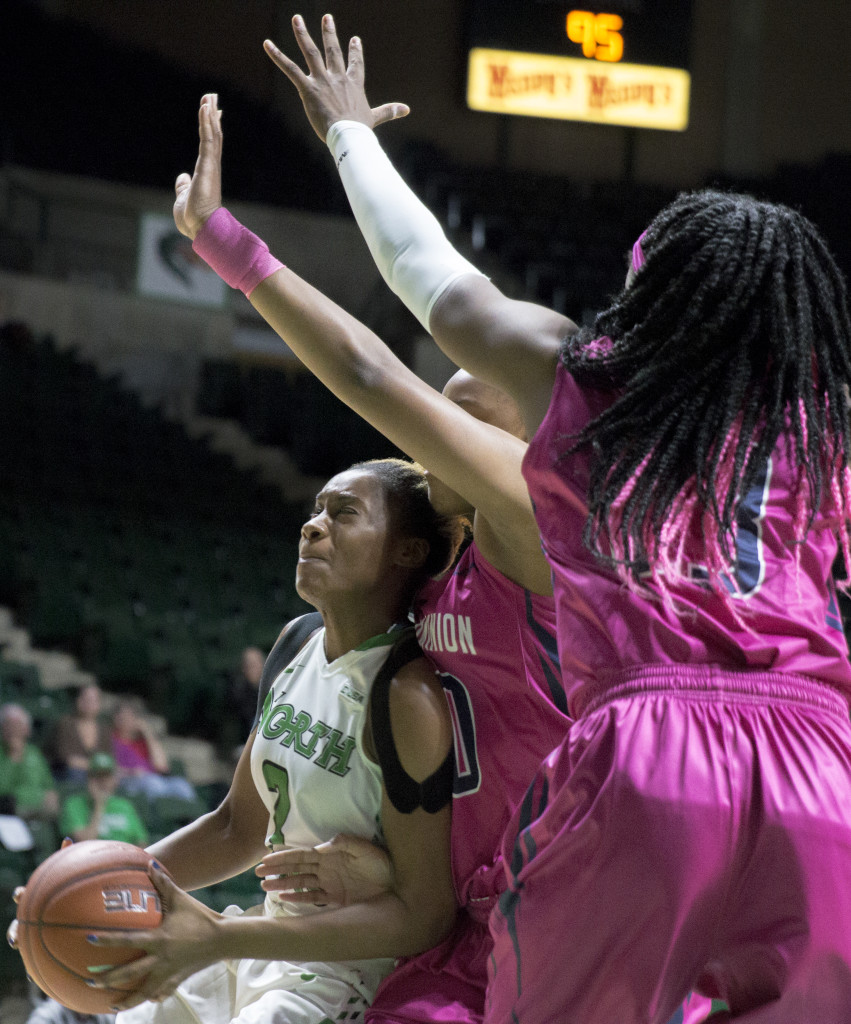 North Texas senior guard Teadra Jones drives the basket against Old Dominion University. Colin Mitchell | Senior Staff Photographer