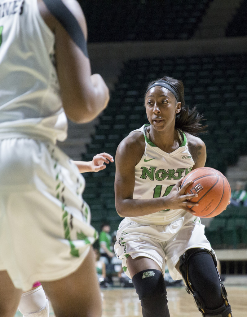 North Texas junior guard Candice Adams looks to pass against Old Dominion University. Colin Mitchell | Senior Staff Photographer