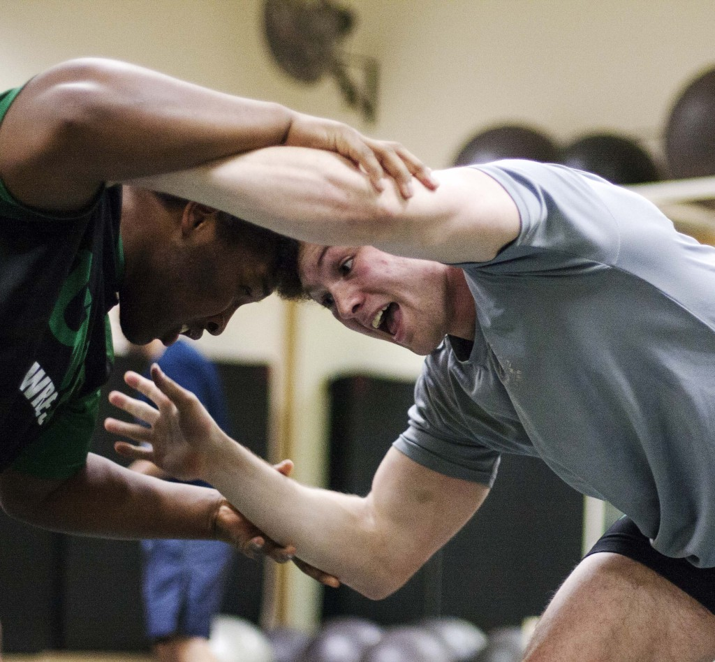 Marketing sophomore David Wojciki (right) locks up with his opponent at wrestling practice. Nathan Roberts | Staff Photographer