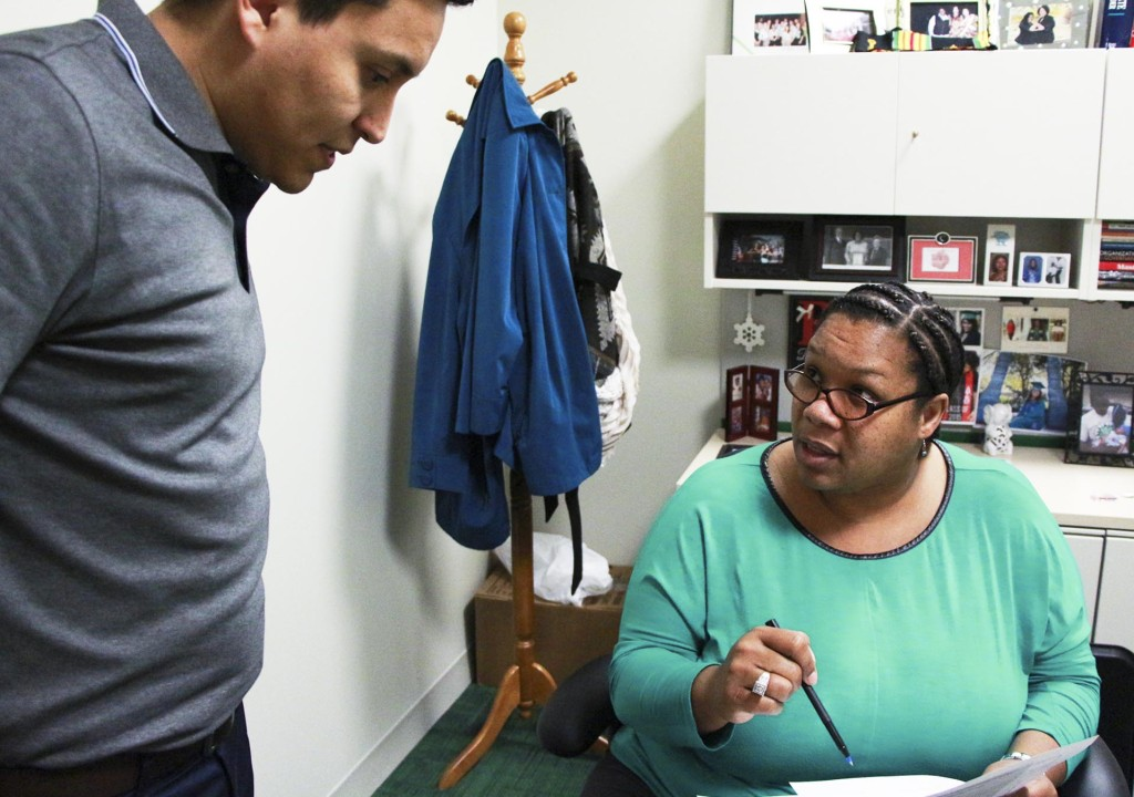 Multicultural Director and Adviser, Cheylon Brown, discusses plans for the day with Multiculture Center Assistant Director, Damian Torres, Wednesday, Feb. 17, 2015. Kaylen Howard| staff photographer.