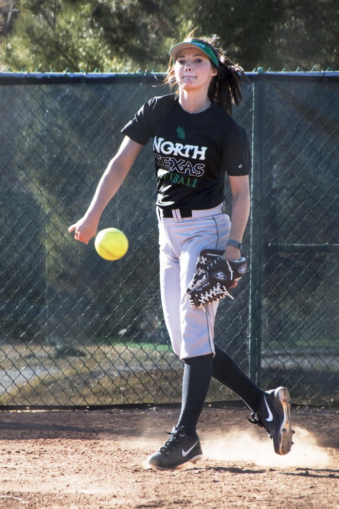 Freshman pitcher Lauren Craine throws the ball during a bullpen session before team practice beings. Dylan Nadwodny   Staff Photographer