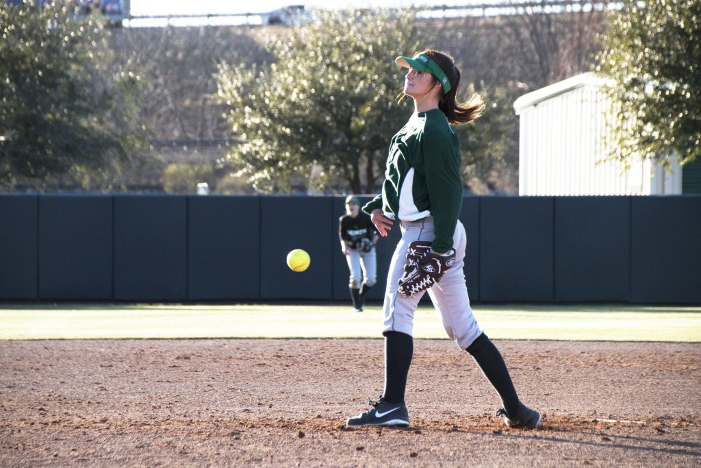 Freshman pitcher Lauren Crine throws the ball towards the plate during team pratcie. Dylan Nadwodny   Staff Photographer