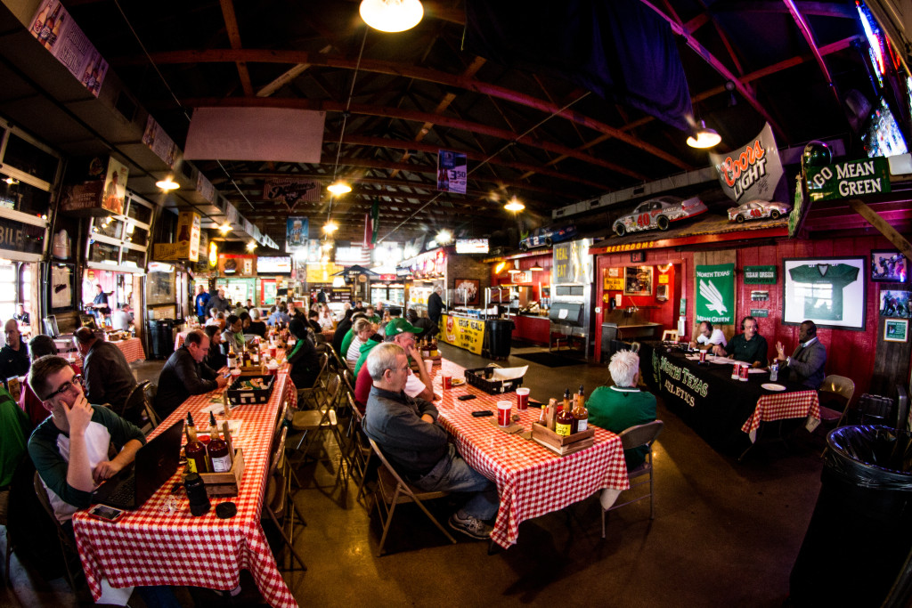 The Coach's Show is hosted every Monday at noon on 88.1 KNTU at Rudy's BBQ off of I-35E near Teasley Lane. Dylan Nadwodny | Staff Photographer