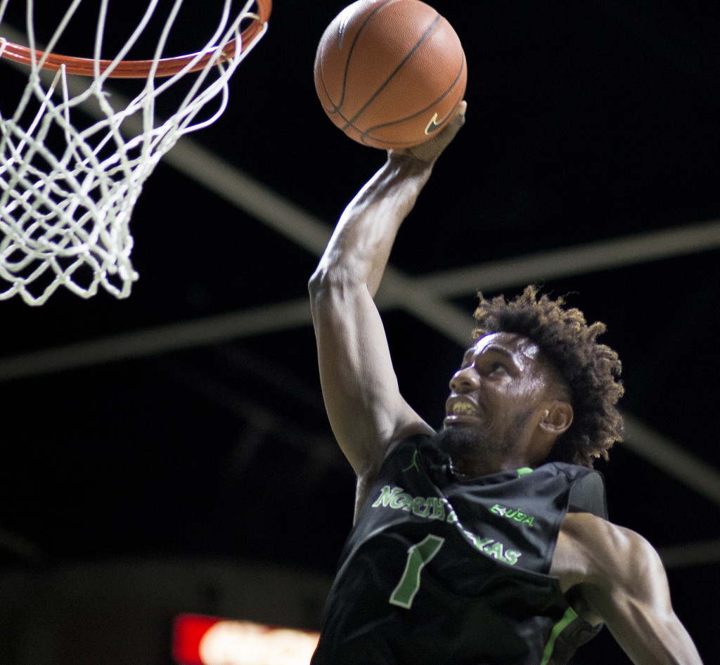 North Texas sophomore forward Jeremy Combs (1) dunks against FAU. Colin Mitchell   Senior Staff Photographer