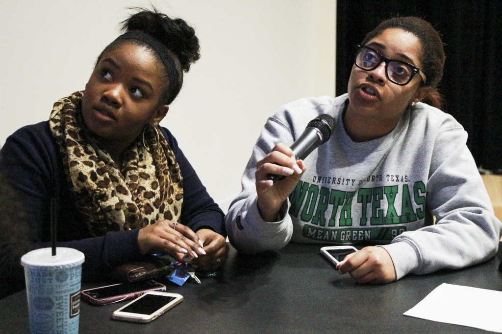 NAACP contestant Bianca Johnson (right) confidently answers a triva question during UPC's Black History Bowl, Tuesday, Feb. 23, 2016. | Staff Photographer Kaylen Howard. Talryn Oliver (left) waits patiently