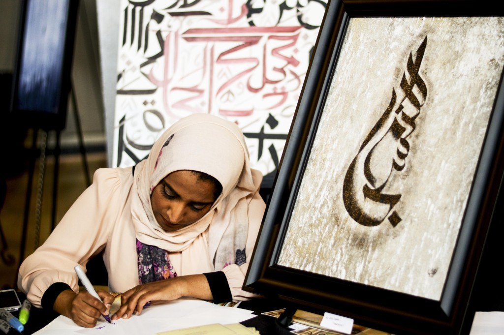 Dena Othman wrote local's names in Arabic at the Dallas Festival of Ideas. Haley Yates | Staff Photographer