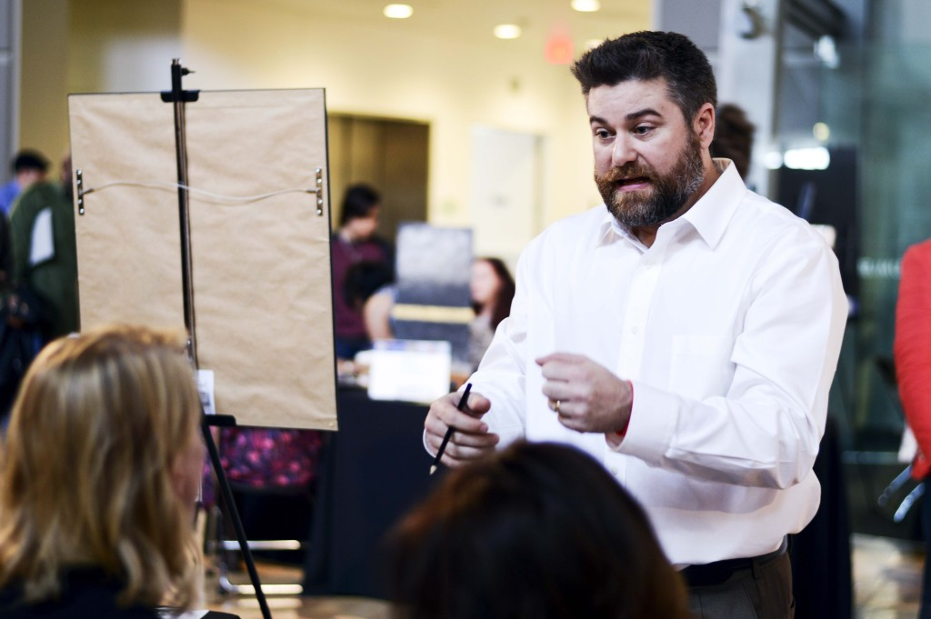 Pencil portrait artist Jason Kinney held a mini workshop at the Dallas Festival of Ideas where he showed individuals how to reproduce his art style. Haley Yates | Staff Photographer