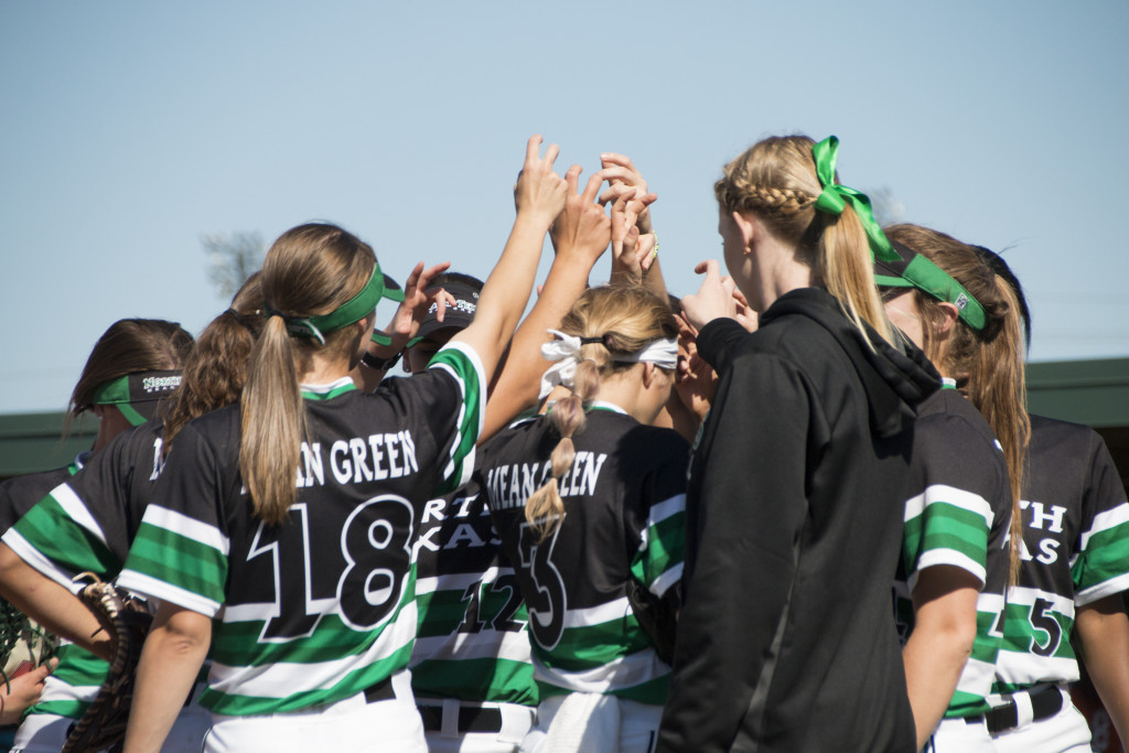 The Mean green softball team breaks their huddle on the third base side after a half inning against Sam Houston State in the Mean Green Invitational. Dylan Nadwodny | Staff Photographer