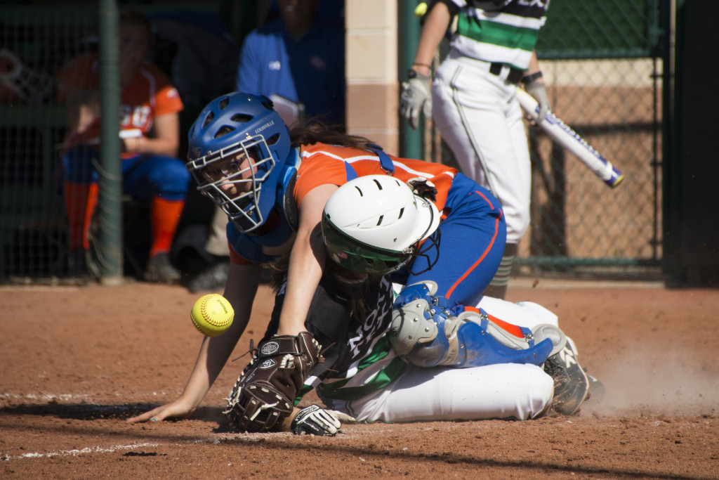 Senior infielder Karly Williams (21) slides into home to score against Sam Houston State in the Mean Green Invitational. Dylan Nadwodny | Staff Photographer