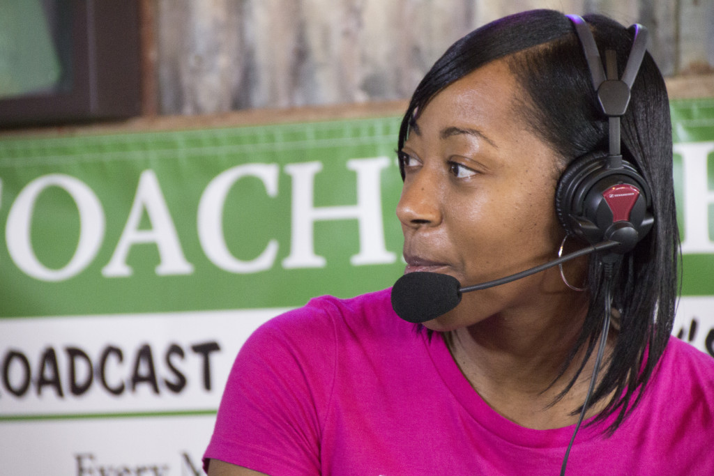 North Texas women's head coach Jalie Mitchell turns to ask Steven Bartolotta some questions on the Coach's Show at Rudy's BBQ. Dylan Nadwodny | Staff Photographer