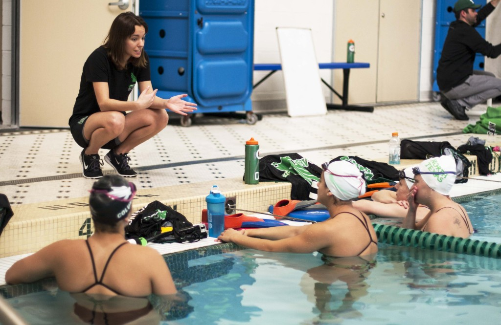 Volunteer Assistant Coach Jessica Rodriguez reviews the swimming exercise with the team. Nathan Roberts | Staff Photographer