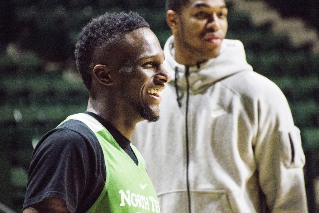 Junior guard Deckie Johnson laughs at something a teammate says during a practice. Dylan Nadwodny | Staff Photographer