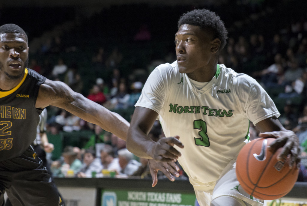 North Texas freshman guard Ja'Michael (3) drives the baseline against Southern Mississippi. Colin Mitchell | Senior Staff Photographer