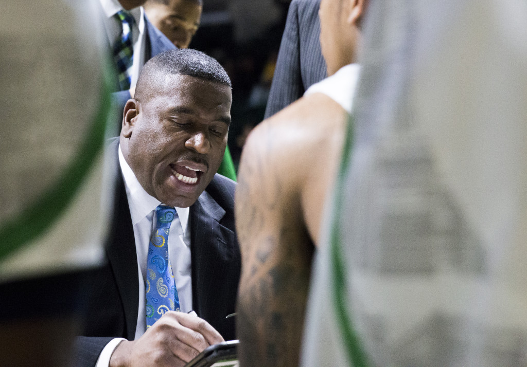 North Texas head coach Tony Benford draws up plays during a timeout. Colin Mitchell | Senior Staff Photographer