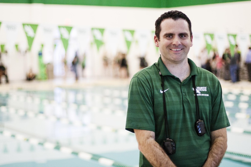 Women's swimming head coach Brandon Brey poses for a portrait after their meet against TCU. Nathan Roberts   Staff Photographer