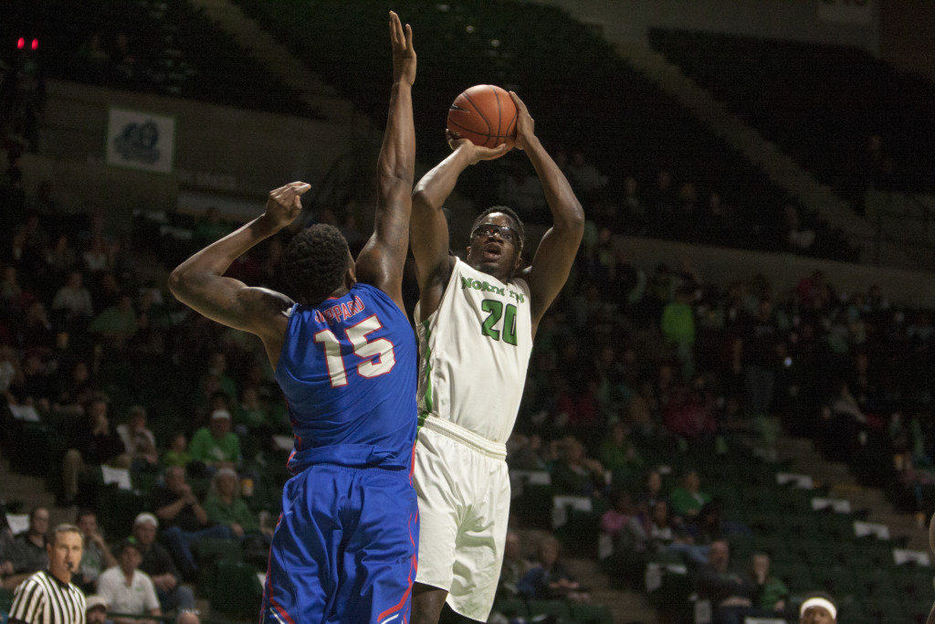 North Texas senior forward Eric Katenda (20) fades away from the defender to get the basket against Louisiana Tech. Nathan Roberts | Contributing Photographer