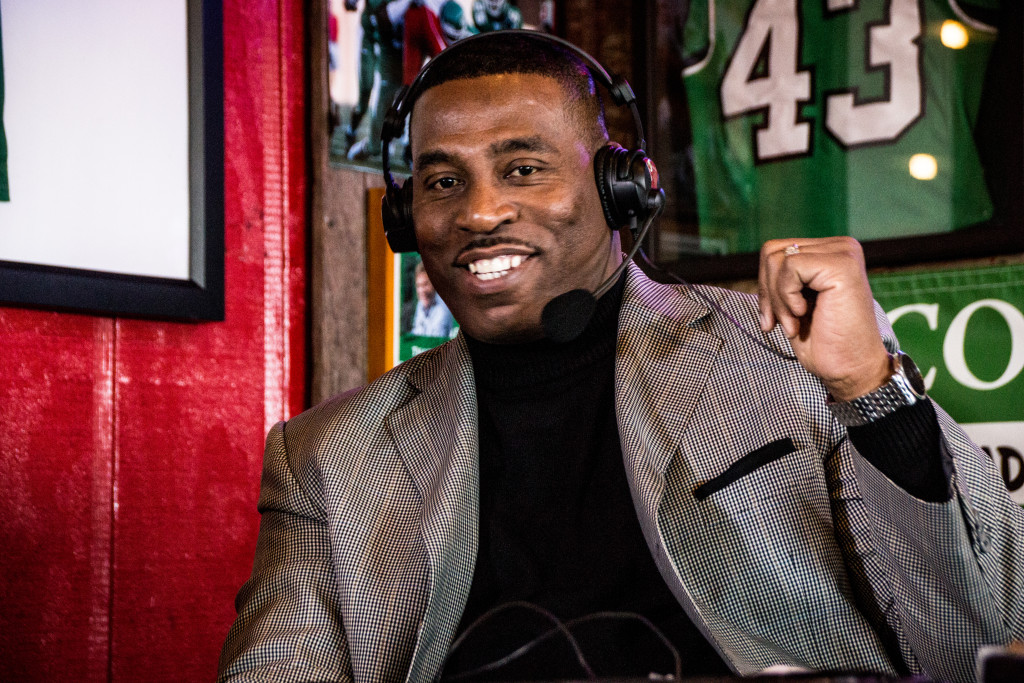 North Texas men's basketball head coach Tony Benford grins as he talks about Rickey Brice's passion on the court on the Coach's Show at Rudy's BBQ. Dylan Nadwodny | Staff Photographer