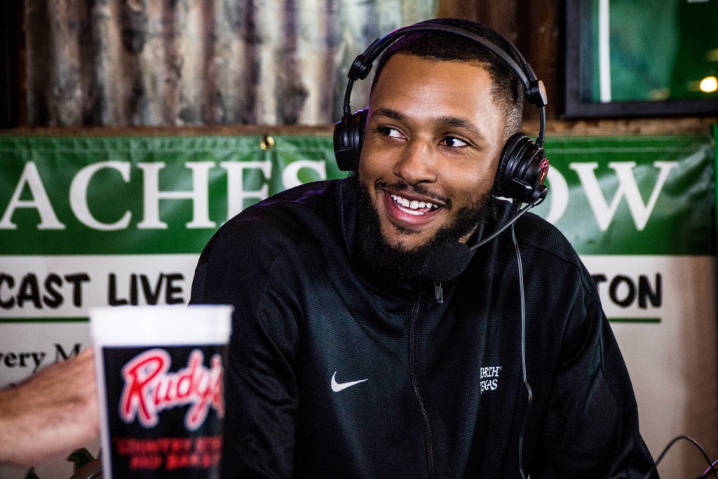 North Texas freshman guard Allante Holston smiles as he talks with Dave Barnett on the Coach's Show at Rudy's BBQ. Dylan Nadwodny | Staff Photographer