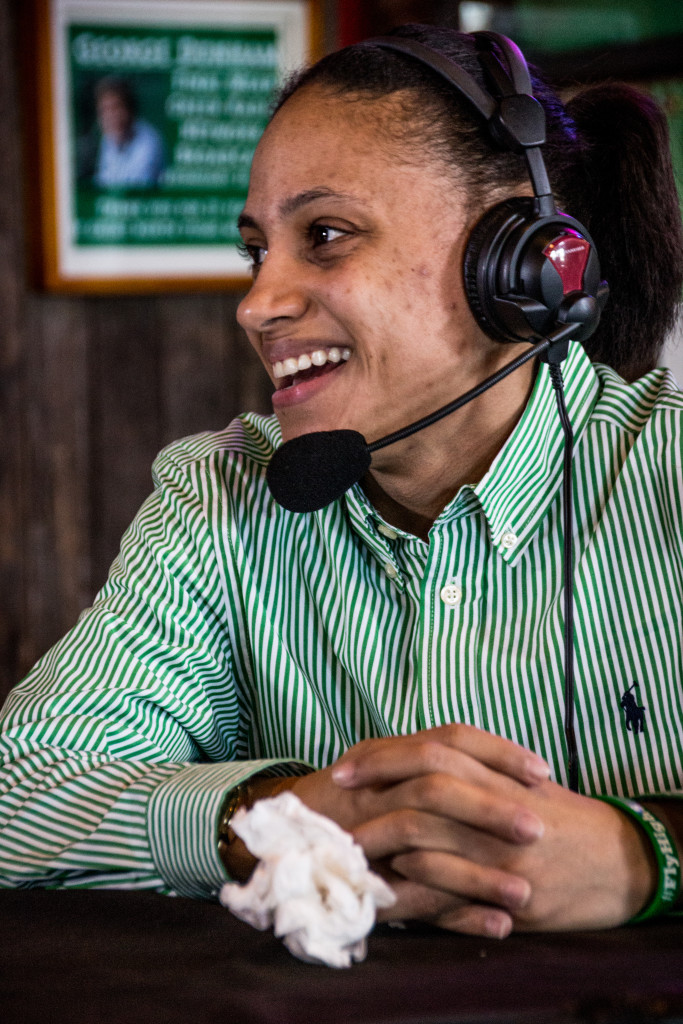 Senoir guard Kassiney Williams smiles as she talks with Steve Bartolotta on the Coach's Show at Rudy's BBQ. Dylan Nadwodny | Staff Photographer