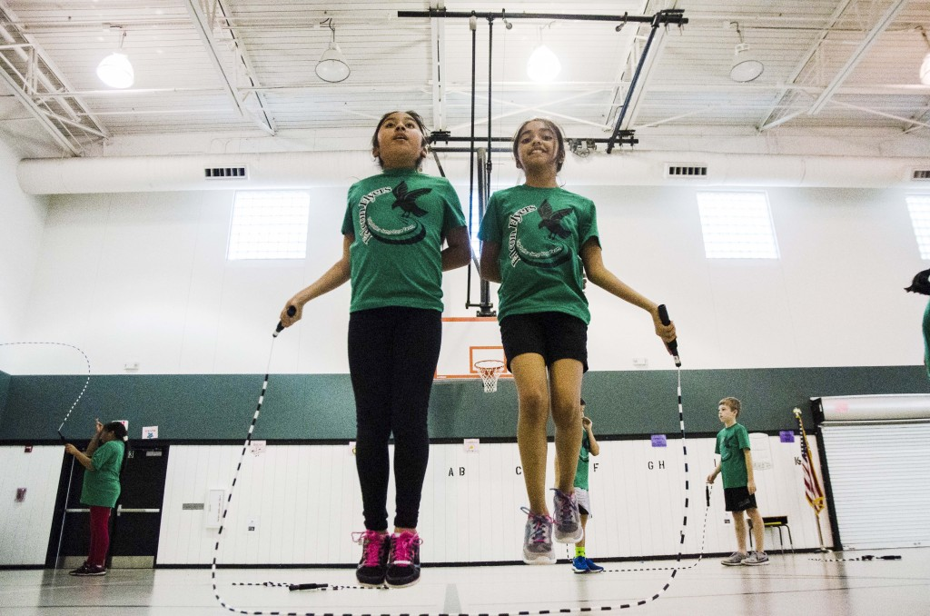 Viri Apaez and Flor Cedillo practice jump roping together at their after school program Falcon Flyers. Hannah Ridings | Senior Staff Photographer