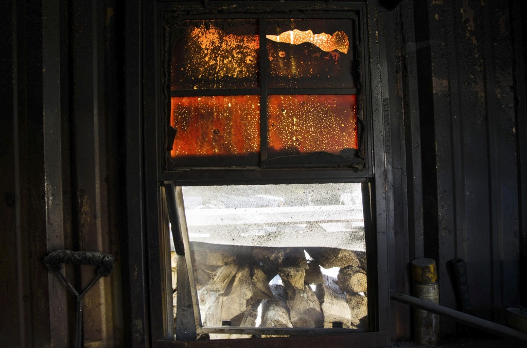 The windows inside the smoker shed remain burned after a grease fire a couple months ago set the smokehouse on fire. Hannah Ridings | Senior Staff Photographer