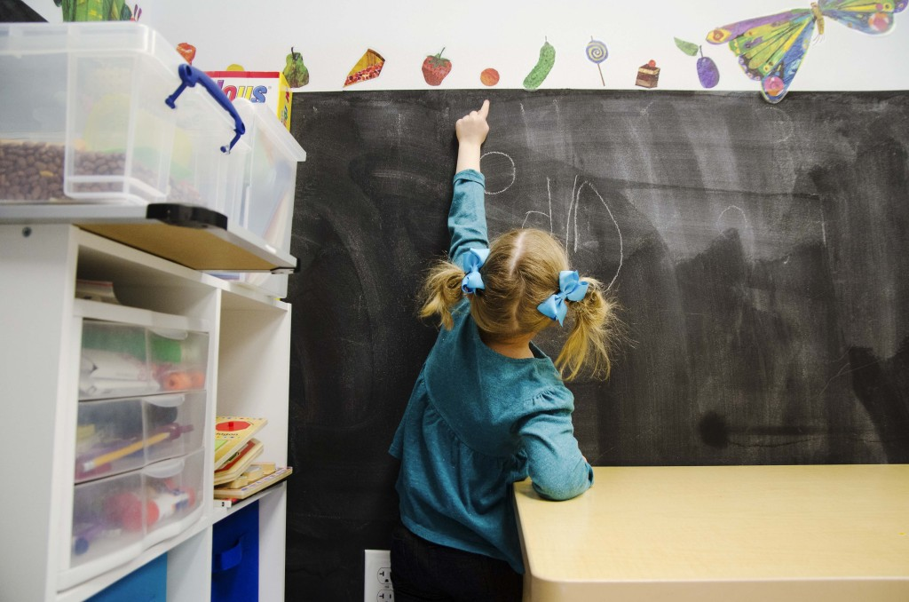 Audrey Sanders points out fruit she knows about the chalkboard at Keystone Pediatric Therapy. Hannah Ridings | Senior Staff Photographer