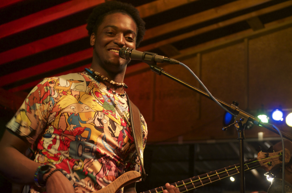 Friday's Foolery bassist Kevin Gray Jr. grins as he performs onstage Saturday night for Thin Line Film Fest. Erica Wieting | Features Editor
